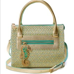 Satchel bag with seahorse and leather trim.
